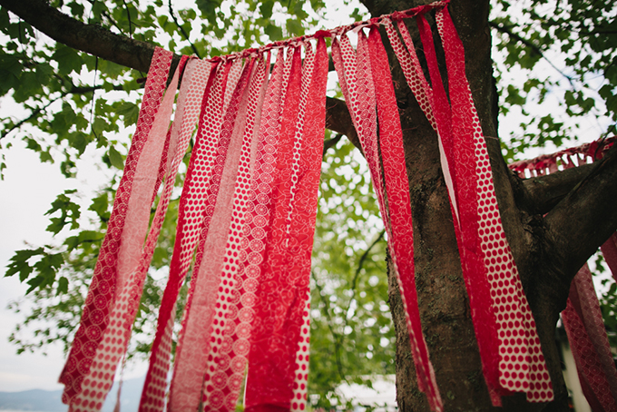 red fabric streamers | Jamie Delaine Photography