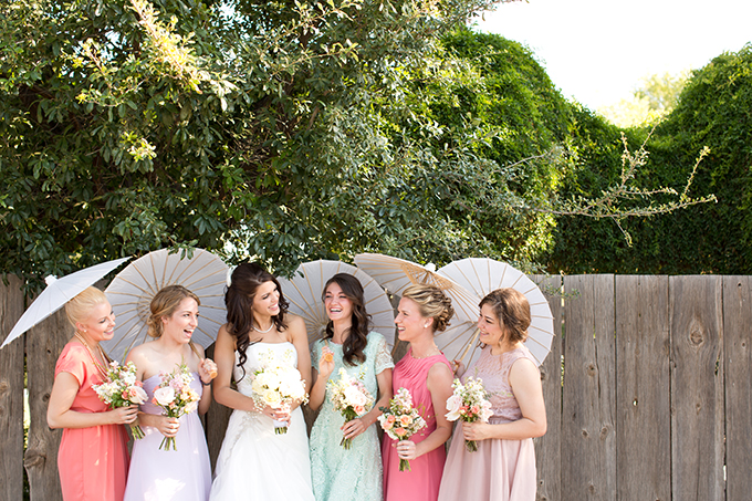 pink and mint bridesmaids with umbrellas | Amy & Jordan Photography