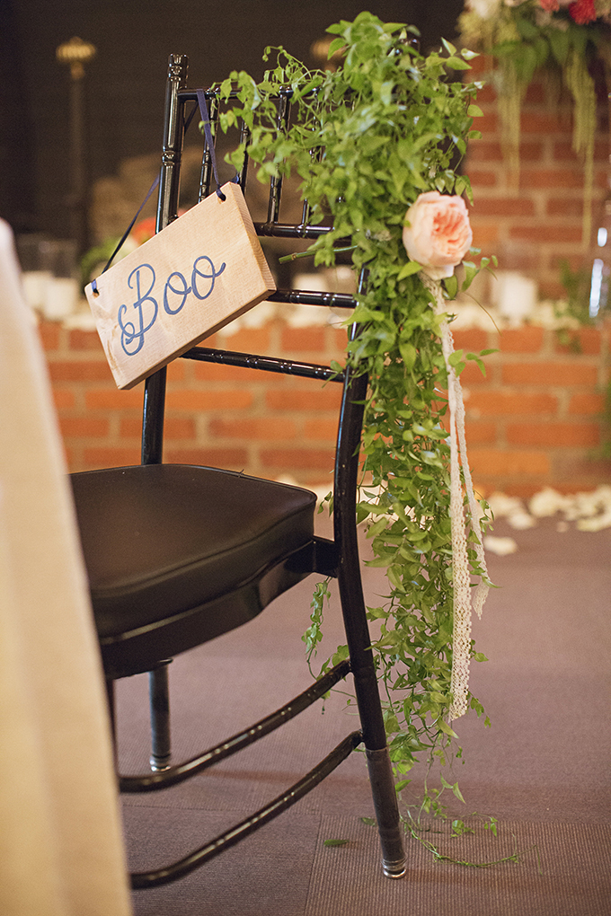 greenery covered sweetheart chair | Brooke Courtney Photography | Glamour & Grace