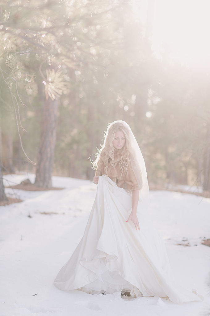 snowy bridal session   Julie Paisley Photography   see more http://www.glamourandgraceblog.com/2014/photo-fridays-snowy-bridal-session