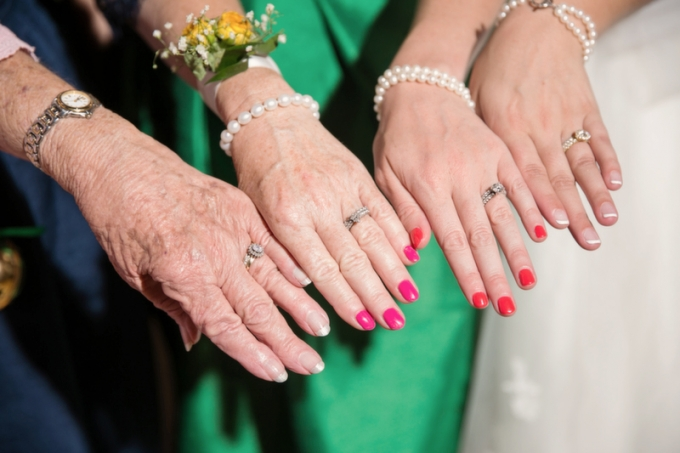 bride with her sister, mom, and grandmother at her wedding | Macon Photography